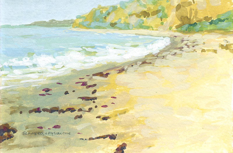Gouache painted beach scene with reddish brown seaweed on the golden sand