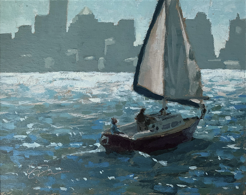 sailboat glides in Boston harbor with the city in the background